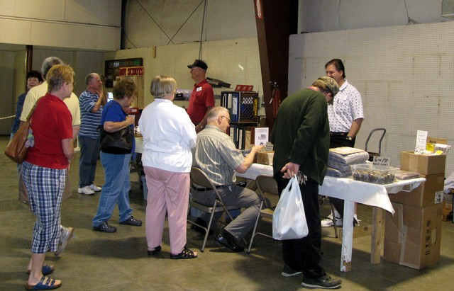 2010 Show-There's always a crowd around the coins