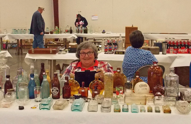 Nancy Lawson not only set up to sell, but also set up her cowboy memorabilia display