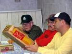 Sam Crowder, Carl Bailey and Harold Carlton inspect Dr. Enuff case