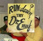 Sam Crowder displays his Dr. Enuff Sign