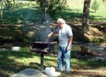 Head Chef, Carl Bailey prepares wonderful hamburgers and hot dogs for the meal.