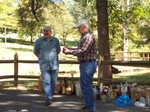 Carl Bailey & Wade Cox inspecting auction items-2010 picnic.